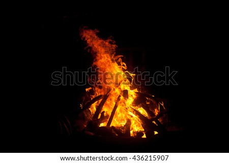 Image of a large campfire at nigt #436215907