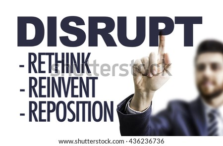 Business man pointing the text: Disrupt