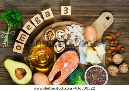 Animal and vegetable sources of omega-3 acids as salmon, avocado, linseed, eggs, butter, walnuts, almonds, pumpkin seeds, parsley leaves and rapeseed oil #436300522