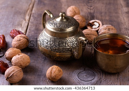 Traditional arabic tea set, walnut and dried dates.