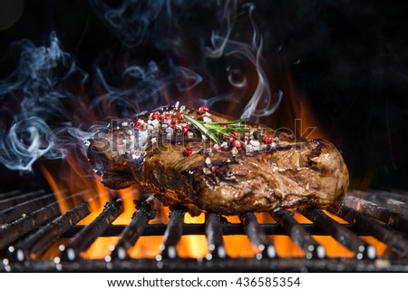 Grilled beef steak on the grill, close-up. #436585354