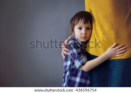 Sad little child, boy, hugging his mother at home, isolated image, copy space. Family concept #436596754