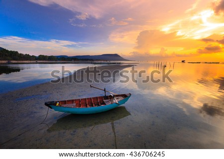 magic sky and cloud amazing reflection at dawn with a fisherman boat -  reflection natural image