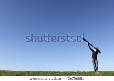Young girl with telescope watching the sky #436706581