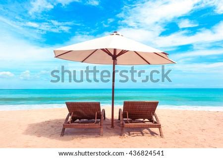 Beautiful Maldive beach. Beach chairs on the white sand beach with cloudy blue sky #436824541