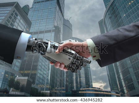 Business Human and Robot hands in handshake. Artificial intelligence technology Design Concept. Friendship between Artificial and real man conceptual template. Royalty-Free Stock Photo #436945282