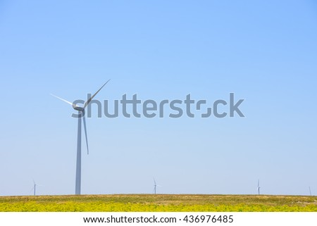 Windmills for electric power production on blue sky  background #436976485