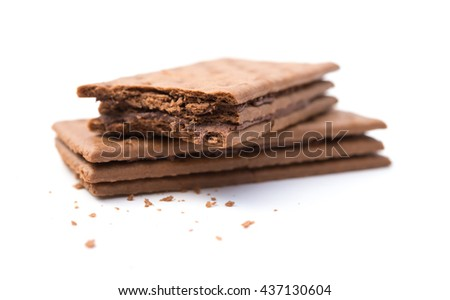 chocolate flavor sandwich biscuits with bites on a white background #437130604