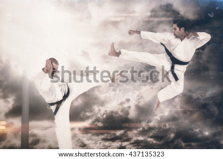 Fighter performing karate stance against overhead view of playing field #437135323