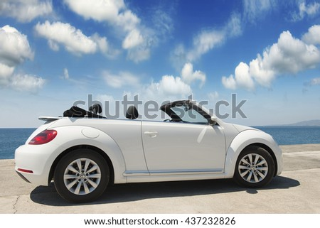 GREECE. ISLAND RODOS- June 16, 2013. The car is a Volkswagen convertible on the waterfront of the city of Rhodes test drive. Greece, Rhodes #437232826