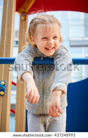 girl playing at the playground #437248993