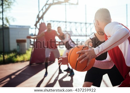 Man passing the ball to another player.