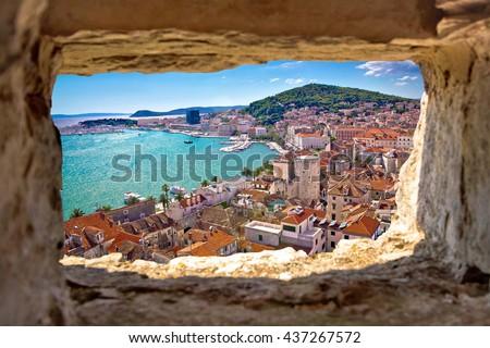 Split  bay aerial view through stone window, Dalmatia, Croatia Royalty-Free Stock Photo #437267572