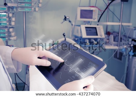 Doctor with advanced equipment in hospital ward. #437274070