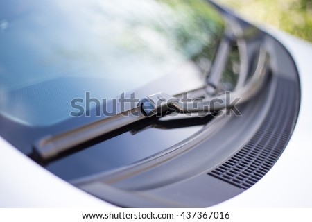 close up of car windshield rain wipers Royalty-Free Stock Photo #437367016