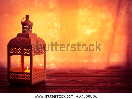 Beautiful background with a shining lantern Fanus. The Muslim feast of the holy month of Ramadan Kareem. Free space for your text #437588086