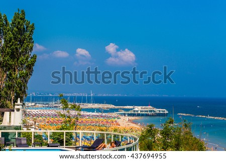 spectacular and colorful view of the beaches of the Marche region in Italy papered by umbrellas in rows in seaside resorts #437694955