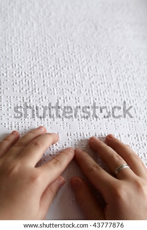 hands of children and Braille print #43777876