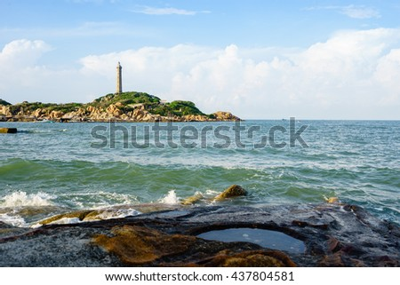 VIETNAM - 12 JUNE 2016: Ke Ga Cape is a beautifull headland in Ham Thuan Nam District, Phan Thiet City, Vietnam. This place is called Ke Ga because its headland looks like the shape of a chicken head. #437804581