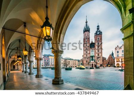 Beautiful Krakow market square, Poland, Europe. Faded colors. Royalty-Free Stock Photo #437849467