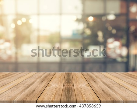 Wooden board empty table in front of blurred background. Perspective brown wood over blur in coffee shop - can be used for display or montage your products.Mock up for display of product. Royalty-Free Stock Photo #437858659