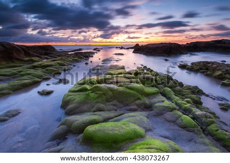 green moss ont the rock boulders during sunset at Kudat Sabah Malaysia. Long exposure. Image contain soft focus and blur. #438073267