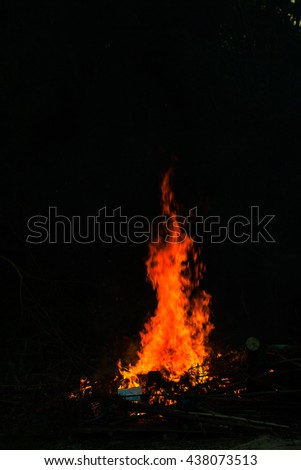 Flames in a bonfire on black background #438073513