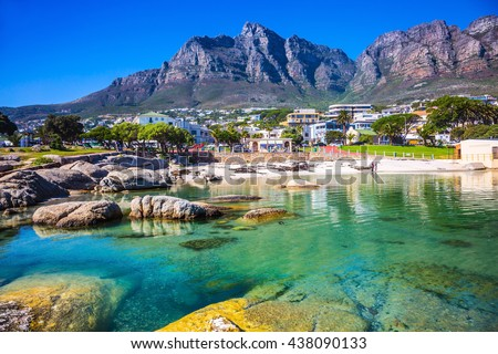 Panorama of Cape Town, South Africa. The city beach against magnificent mountains Royalty-Free Stock Photo #438090133