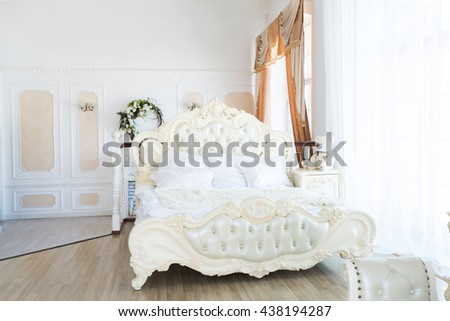 Luxury stylish bright light interior of apartment. White walls decorated by ornament. Nobody inside room. bedroom. #438194287