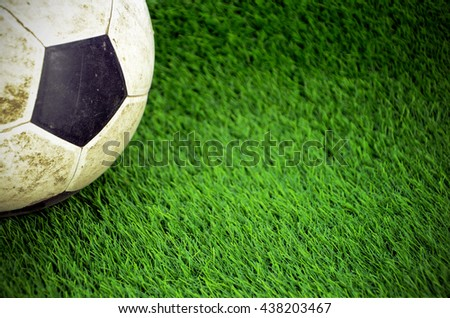 Shabby soccer ball on artificial turf field. #438203467