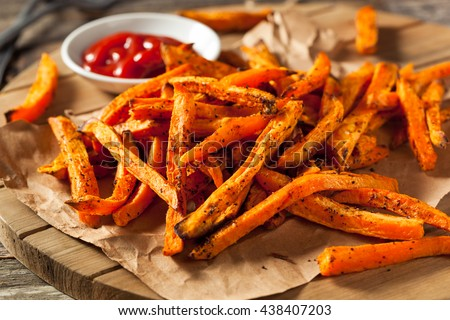 Healthy Homemade Baked Sweet Potato Fries with Ketchup Royalty-Free Stock Photo #438407203