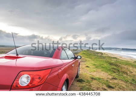 SOZOPOL, BULGARIA - MAY 3: Red car Renault Megane Cabriolet on the wild sand sea beach, on May 3, 2016 in Sozopol, Bulgaria. #438445708