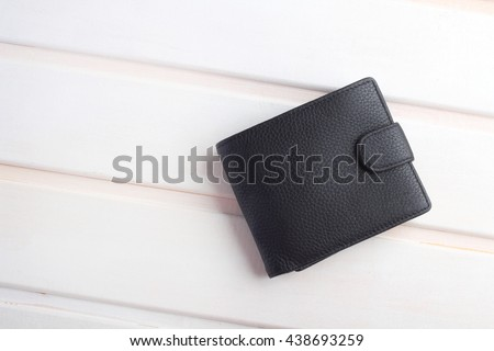 men's black wallet money in cash wooden white vintage background Royalty-Free Stock Photo #438693259