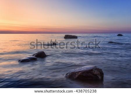 Rocks in the sea at sunset in  Estonia #438705238