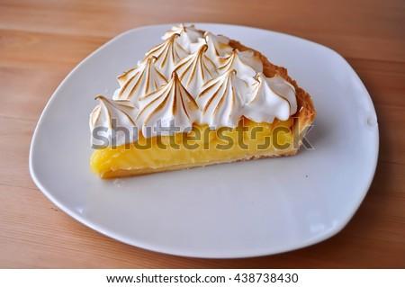 Lemon Tarts in plate white on wooden table.