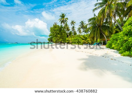 Beautiful tropical Maldives island with beach , sea , and coconut palm tree on blue sky for nature holiday vacation background concept -Boost up color Processing #438760882