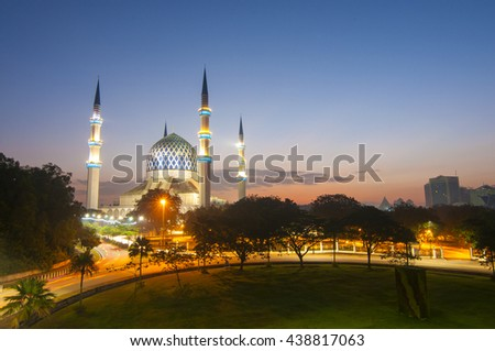 the sunrise image of mosque. soft focus and motion of the sky and water due to long exposure setup. #438817063