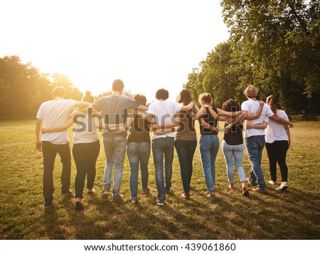 large group of friends together in a park having fun Royalty-Free Stock Photo #439061860