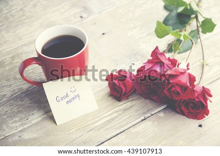 coffee, rose and '' good morning '' writing on paper
