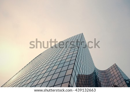 Skyscrapers with glass facade. Modern buildings in Paris business district. Concepts of economics, financial, future.  Copy space for text. Dynamic composition. Toned image #439132663