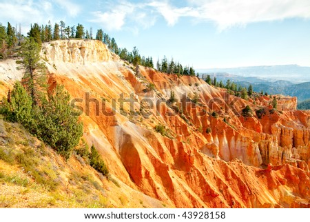 green forest on the edge of orange hoodoo formations #43928158