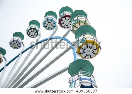 Big Ferris wheel. Big Ferris wheel in the cloudy weather. fairest. observation wheel. cloudy day. gloomy weather  #439350397