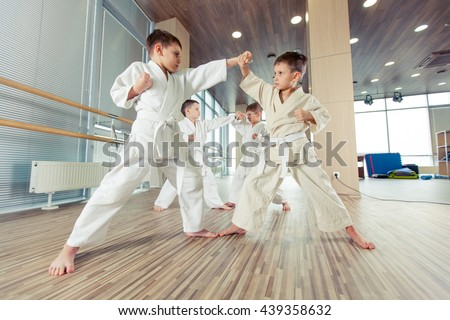 young, beautiful, successful multi ethical kids in karate position Royalty-Free Stock Photo #439358632