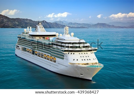 Luxury Cruise Ship Sailing from Port Royalty-Free Stock Photo #439368427