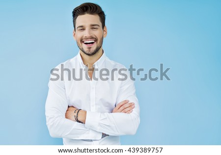 Sexy smiling handsome man with crossed arms #439389757