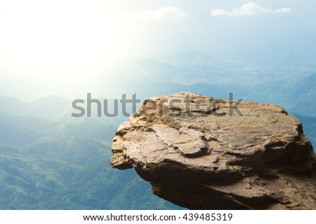 Standing empty on top of a mountain view, Blank space cliff edge with mountain on clouds blue sky #439485319