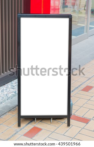Blank white signboard stand on the storefront.