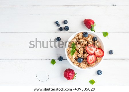 Cereal. Breakfast with muesli and berries. Top view, flat lay. #439505029