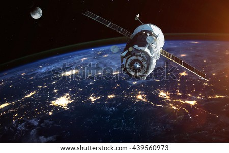Spacecraft Launch Into Space. Elements of this image furnished by NASA. Royalty-Free Stock Photo #439560973