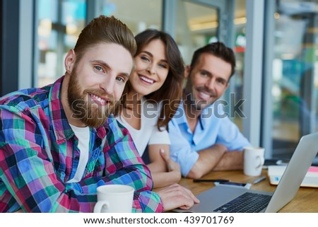 Group of three happy friends at cafe planning  new business #439701769